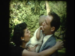 50s glam mom, dad, & grandmother with new baby - stock footage