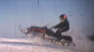 Stock Video Footage of Snowmobiling Jumps (1975 Vintage 8mm film)