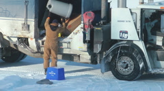Man Empties Trash Cans Into A Garbage Truck Curb Side In Winter Canada Stock Footage