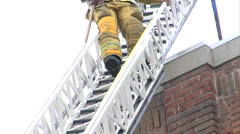 Fireman come down ladder Stock Footage