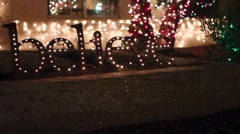 Christmas Twinkling Holiday Light Up Sign - Believe - stock footage
