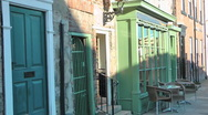 Quaint Cafe with tables and chairs outside old fashioned green painted window, Stock Footage
