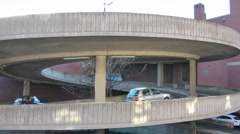 Cars on spiral concrete ramp to rooftop carpark. Stock Footage
