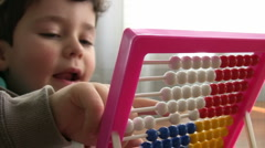 Little Boy using abacus - stock footage