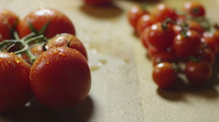Bunch of wet tomatoes on kitchen table - stock footage