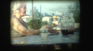 Miserable elderly woman at picnic table Stock Footage