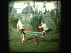 Boys spin on whirly gig backyard ride Stock Footage