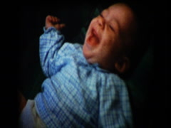 Smiling happy 2 month old infant baby boy - stock footage