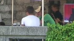 Men at Bar Terrace Stock Footage