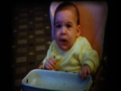 Baby sneezes in high chair and funny face Stock Footage