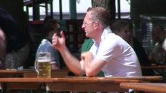 Man Drinking in Beer Garden - stock footage