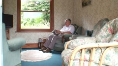 Old Man in Sitting Room Stock Footage