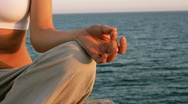 Stock Video Footage of Female body meditating by the sea, closeup