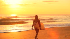 Young Surf Girl at Sunrise Stock Footage