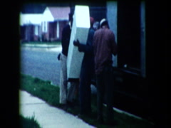 Movers loading moving truck Stock Footage