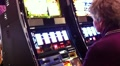 Woman plays slots Footage