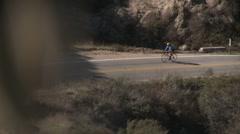Cyclist rack focus Stock Footage