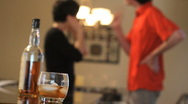 Woman Abuses Man - Alcohol in Foreground Stock Footage