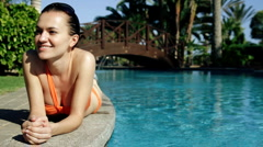 Sexy beautiful woman sunbathing by the pool Stock Footage