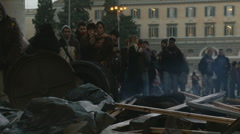 Riot aftermath in Rome. Police van passes damage Stock Footage