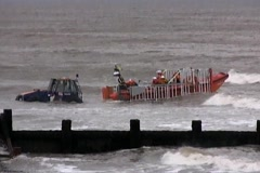 Amphibious tractor tows lifeboat from English Channel Stock Footage