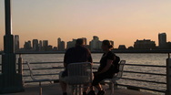 Couple sitting at the Hudson river Stock Footage