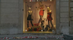 Riot aftermath in Rome. Lingerie shop with Romans walk past damage Stock Footage