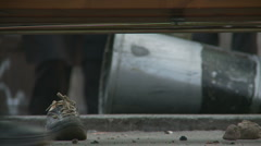 Evidence of a riot in Rome (shoe from protestor) Stock Footage