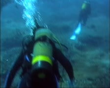 Scuba Divers in Current GFSD Stock Footage