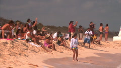 Beach crowd taking photos Stock Footage