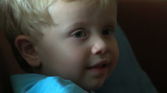 3yo boy watching tv closeup Stock Footage