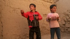 A blind child and friend play with broken kites in Kabul, Afghanistan. Stock Footage