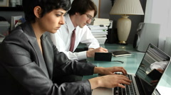 Business Partners Pleased with Results on Laptop Stock Footage
