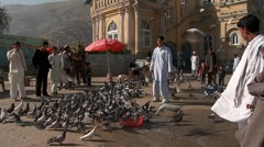 Pigeons fly in front of the Shah-e Do Shamshera Mosque in Kabul, Afghanistan. - stock footage