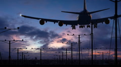 Huge jumbo jet silhouette overhead landing on runway (with audio) Stock Footage