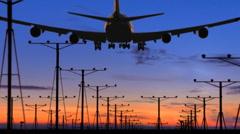Huge jumbo jet silhouette overhead landing on runway (with audio) Stock Footage