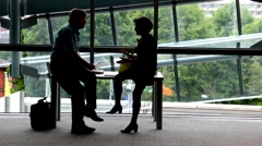 Man and woman are sitting and talking. Stock Footage