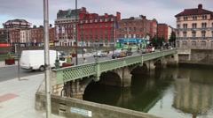 Cars and passers-by cross the Grattan bridge over the river Liffey Stock Footage