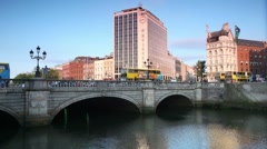 Stock Video Footage of Cars and passer-by on O'Connell bridge on Liffey bridge