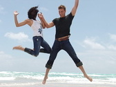 Stock Video Footage of Miami Beach Jumping young couple in slow motion