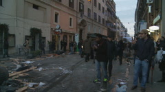 Rome Riot aftermath. Motor bike passes damaged City Stock Footage