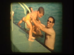 Dad teaches son to swim Stock Footage