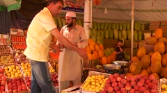 A man shops in a fruit market in Kabul, Afghanistan. Stock Footage