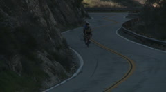 Twincyclists downhill follow Stock Footage