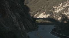 Single cyclist downhill follow Stock Footage