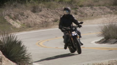 Motorcycles in curve both ways Stock Footage
