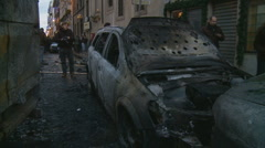 Riot in Rome aftermath - burnt out car Stock Footage