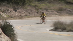 Twin cyclists in curve Stock Footage