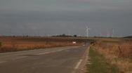 Chrysler300 asphalt road windy windmills2 Stock Footage