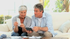 Elderly couple calculating their bills Stock Footage